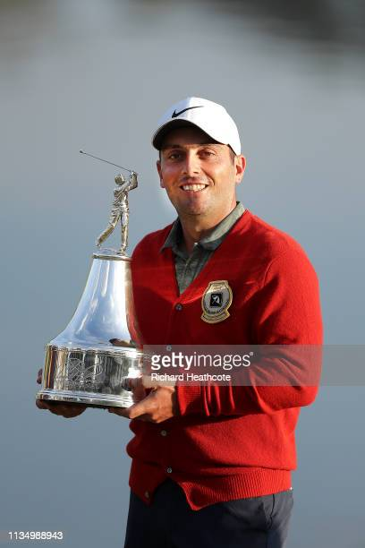 Francesco Molinari of Italy poses with the trophy after winning the Arnold Palmer Invitational Presented by Mastercard at the Bay Hill Club on March...