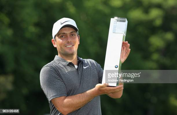 Francesco Molinari of Italy poses with the trophy after winning the BMW PGA Championship at Wentworth on May 27, 2018 in Virginia Water, England.