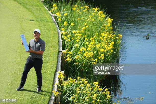 Francesco Molinari of Italy poses with the trophy as he celebrates victory on day four and the final round of the BMW PGA Championship at Wentworth...