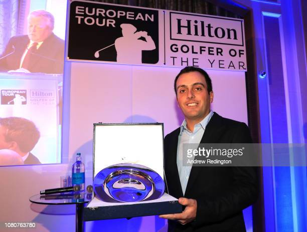 Francesco Molinari of Italy poses with the trophy as he is announced as the 2018 Hilton European Tour Golfer of the Year on December 10 2018 at the...