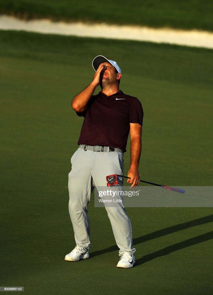 Francesco Molinari of Italy reacts to his putt on the 18th green during the third round of the 2017 PGA Championship at Quail Hollow Club on August 12, 2017 in Charlotte, North Carolina.