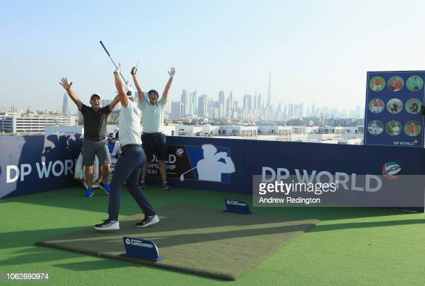 Francesco Molinari of Italy Thorbjorn Olesen of Denmark and Jon Rahm of Spain celebrate after Olesen hit a target during a photo opportunity on the...