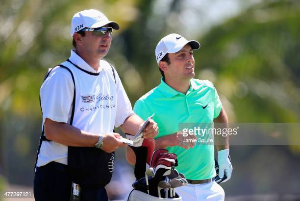 Francesco Molinari of Italy waits with his caddie Jason Hempleman on the first hole during the third round of the World Golf Championships-Cadillac...