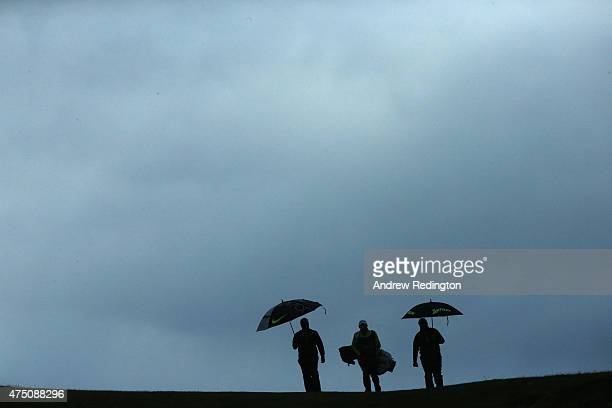 Francesco Molinari of Italy walks down the 9th hole with Shane Lowry during the Second Round of the Dubai Duty Free Irish Open Hosted by the Rory...