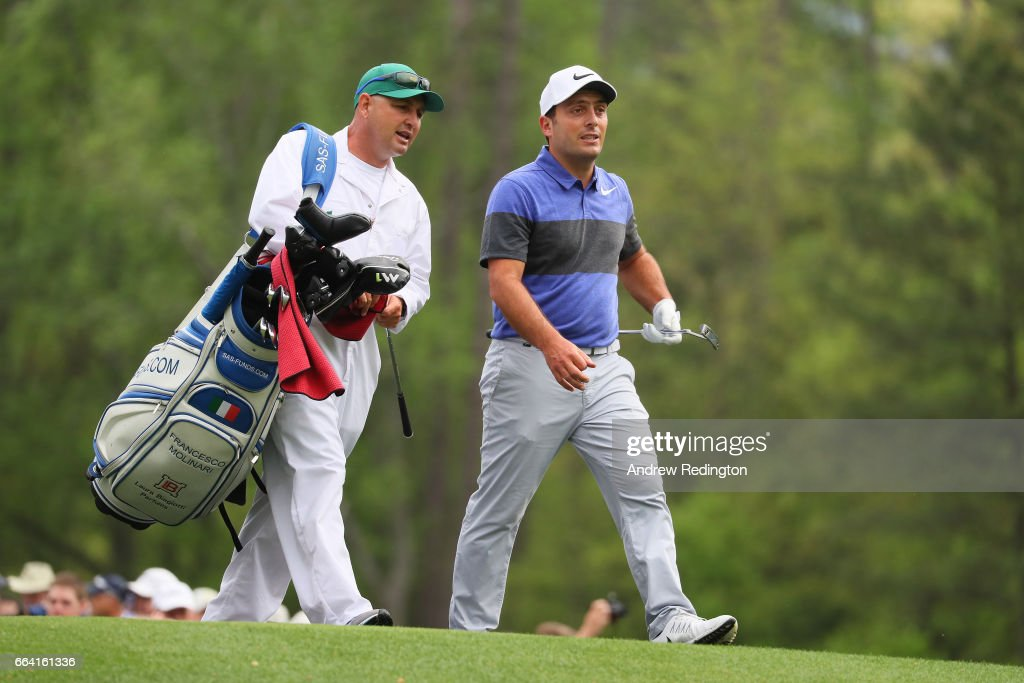 Francesco Molinari of Italy walks with his caddie on the 12th hole during a practice round prior to the start of the 2017 Masters Tournament at Augusta National Golf Club on April 3, 2017 in Augusta, Georgia.