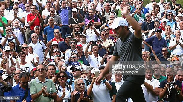 Francesco Molinari of Italy waves to the crowd as they welcome him onto the first tee during the second round of the 72nd Open d'Italia at Golf Club...