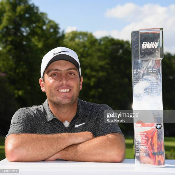 Francesco Molinari of Italy with the winners trophy on the 18th green after the final round of the BMW PGA Championship at Wentworth on May 27 2018...