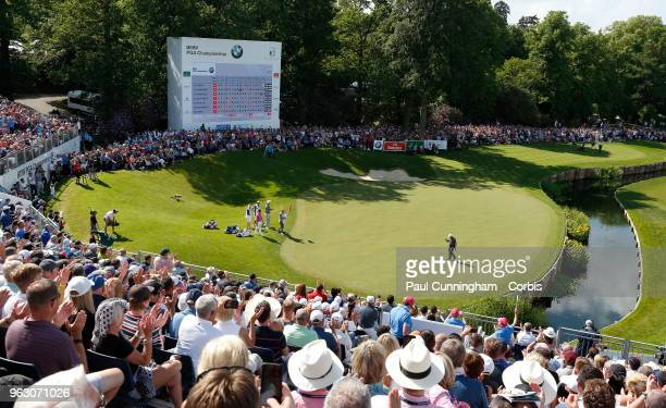 Francesco Molinari punches the air in jubilation after sinking his putt and winning the competition on the 18th and final hole at Wentworth on May 27...