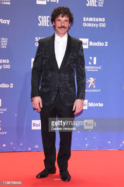 Francesco Montanari walks a red carpet ahead of the 64 David Di Donatello awards ceremony Red Carpet on March 27 2019 in Rome Italy