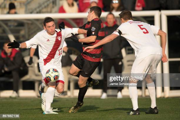 Francesco Moore of Indiana University and Foster Langsdorf of Stanford University battle for the ball during the Division I Men's Soccer Championship...