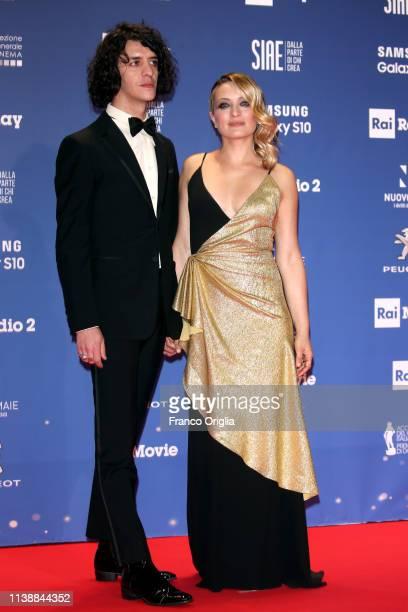 Francesco Motta and Carolina Crescentini walk a red carpet ahead of the 64. David Di Donatello awards ceremony - Red Carpet on March 27, 2019 in...