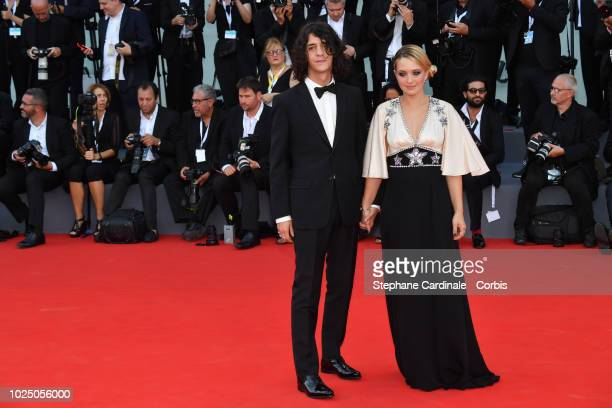 Francesco Motta and Carolina Crescentini walk the red carpet ahead of the opening ceremony and the 'First Man' screening during the 75th Venice Film...