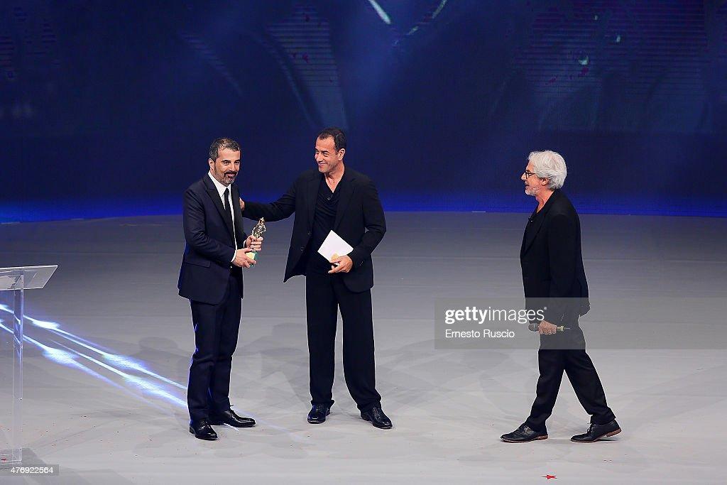Francesco Munzi, Matteo Garrone and Tullio Solenghi attend the '2015 David Di Donatello' Awards Ceremony at Teatro Olimpico on June 12, 2015 in Rome, Italy.