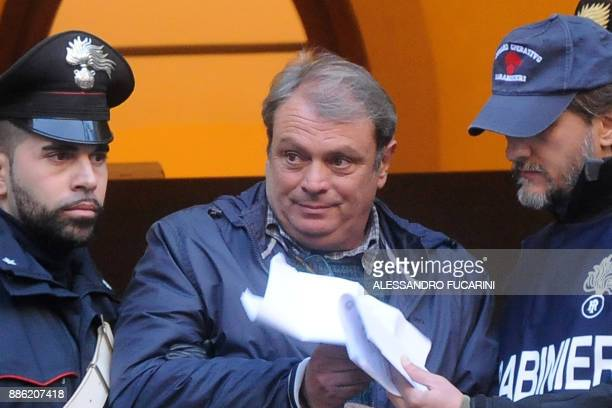 Francesco Paolo Liga a man suspected of mafia association is escorted by carabinieri during a police operation on December 5 2017 in Palermo Maria...