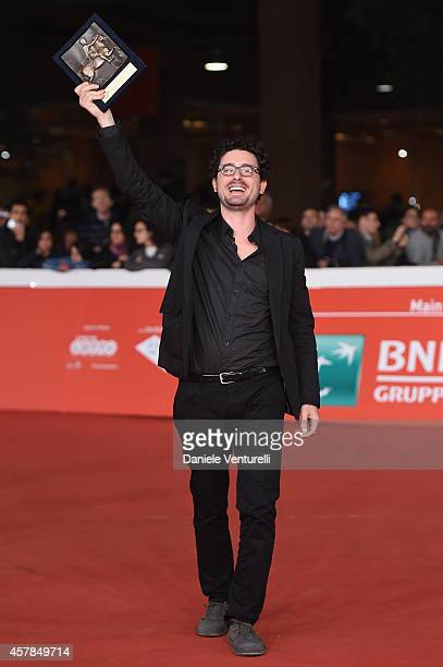 Francesco Raganato poses with the People?s Choice Award during the Award Winners Photocall during the 9th Rome Film Festival at Auditorium Parco...