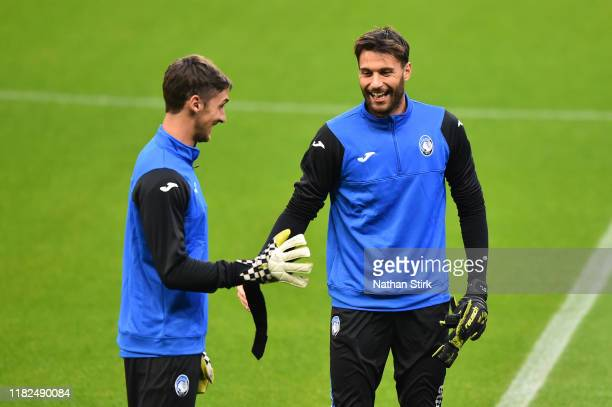 Francesco Rossi and Marco Sportiello of Atalanta speak during a training session ahead of the UEFA Champions League Group C match against Manchester...