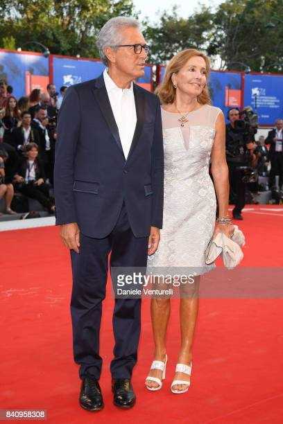 Francesco Rutelli and Barbara Palombelli walk the red carpet ahead of the 'Downsizing' screening and Opening Ceremony during the 74th Venice Film...