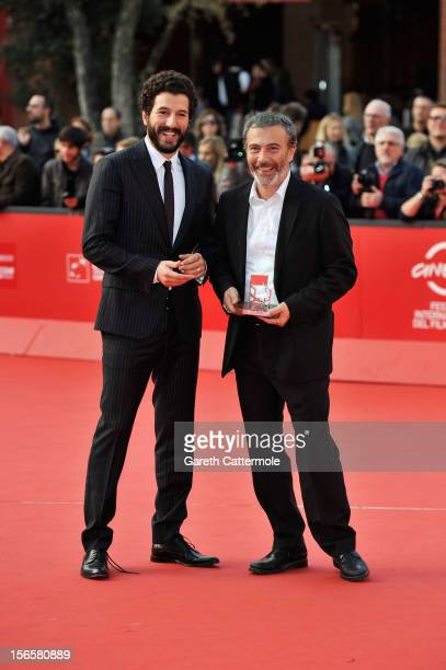 Francesco Scianna and Paolo Sassanelli poses with the LARA Award for Best Italian Actor as he attends the Collateral Awards Red Carpet photocall...