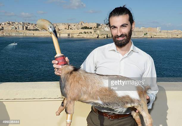 Francesco Sultana holds his Zaqq which is similar to the bagpipes and made from the carcass of a dead Goat which he played for Queen Elizabeth II and...