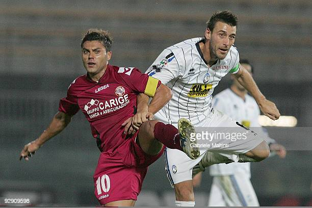 Francesco Tavano of AS Livorno Calcio in action against Giampaolo Bellini of Atalanta BC during the Serie A Tim match between AS Livorno Calcio and...