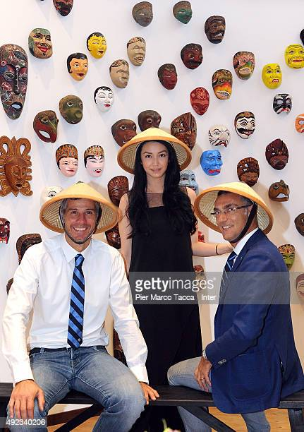 Francesco Toldo former goalkeeper and Giuseppe Bergomi former footballer of FC Internazionale pose with a model during their visit at the Indonesia...