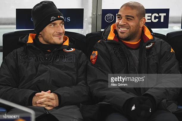 Francesco Totti and Adriano of Roma sit on the substitution bench before the UEFA Champions League group E match between AS Roma and FC Bayern...
