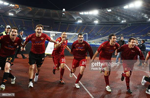 Francesco Totti and teammates of AS Roma celebrate victory after the Serie A match between SS Lazio and AS Roma at Stadio Olimpico on April 18 2010...