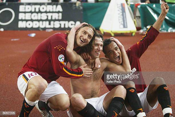 Francesco Totti Antonio Cassano and Alessandro Mancini celebrate during the Serie A Match between Roma and Inter Milan on March 7 in Rome Italy