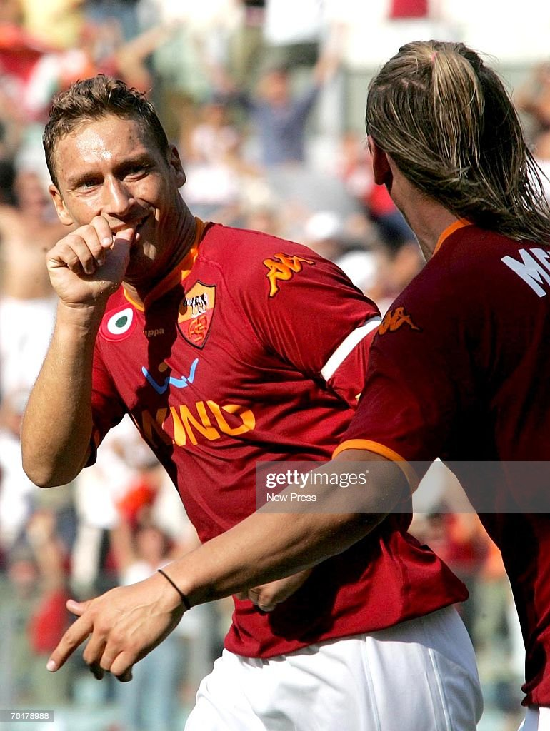 Francesco Totti celebrates scoring the third goal for Roma during a Serie A match between Roma and Siena at the Stadio Olimpico on September 02, 2007 in Rome, Italy.