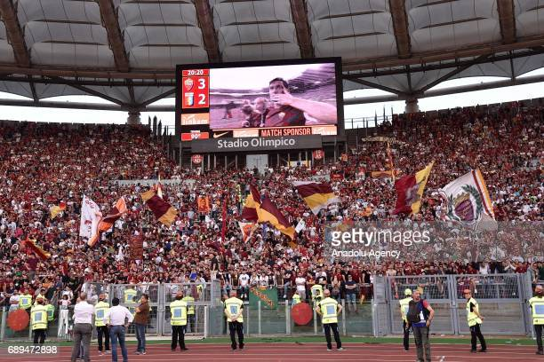 Francesco Totti holds a baby girl as he greets the fans ahead of the Serie A Week 38 match between A.S. Roma and Genoa CFC at Stadio Olimpico in...