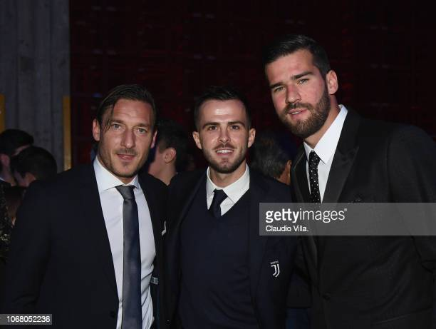 Francesco Totti Miralem Pjanic and Alisson Ramses Becker attend the Gran Gala Del Calcio 2018 on December 3 2018 in Milan Italy