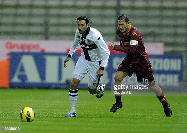 Francesco Totti of AS Roma and Cristian Zaccardo of Parma FC compete for the ball during the Serie A match between Parma FC and AS Roma at Stadio...
