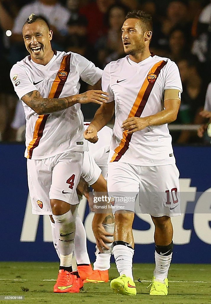 Francesco Totti #10 of AS Roma celebrates a goal with Radja Nainggolan #4 against Real Madrid during a Guinness International Champions Cup 2014 game at Cotton Bowl on July 29, 2014 in Dallas, Texas.