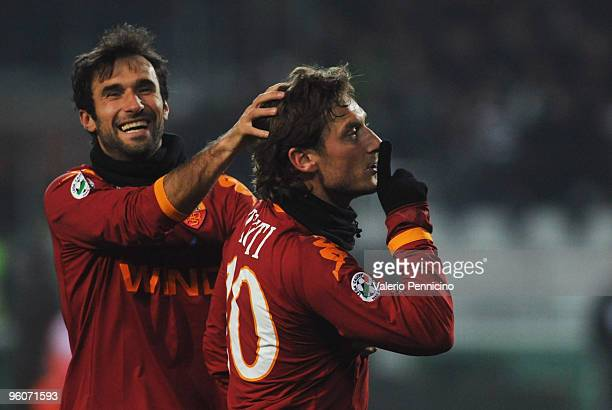 Francesco Totti of AS Roma celebrates his goal with Mirko Vucinic during the Serie A match between Juventus FC and AS Roma at Olimpico Stadium on...