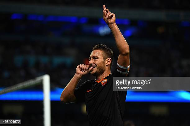 Francesco Totti of AS Roma celebrates scoring his team's first goal during the UEFA Champions League Group E match between Manchester City FC and AS...