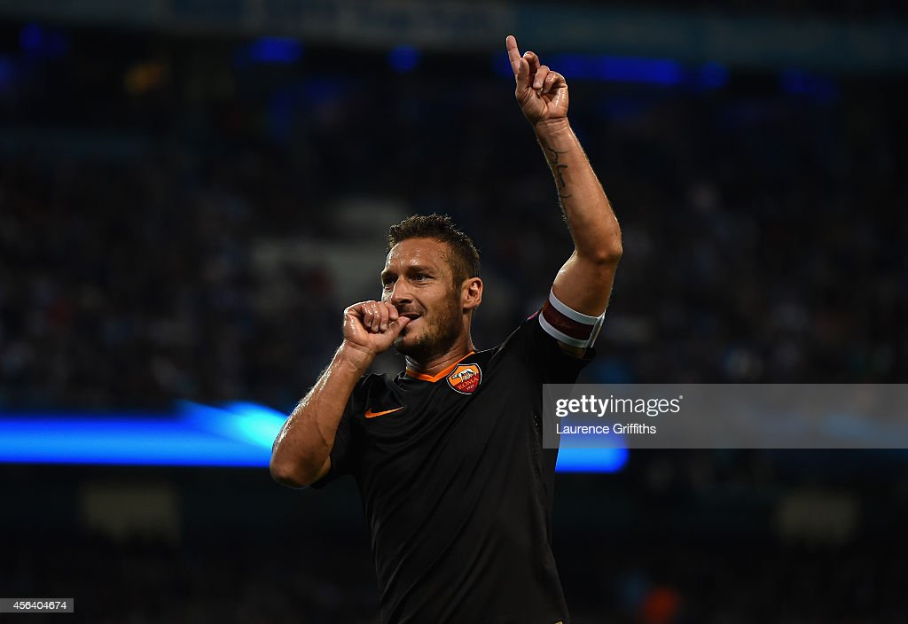 Francesco Totti of AS Roma celebrates scoring his team's first goal during the UEFA Champions League Group E match between Manchester City FC and AS Roma on September 30, 2014 in Manchester, United Kingdom.