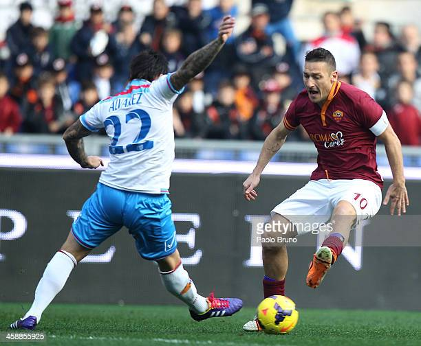 Francesco Totti of AS Roma competes for the ball with Pablo Alvarez of Calcio Catania during the Serie A match between AS Roma and Calcio Catania at...