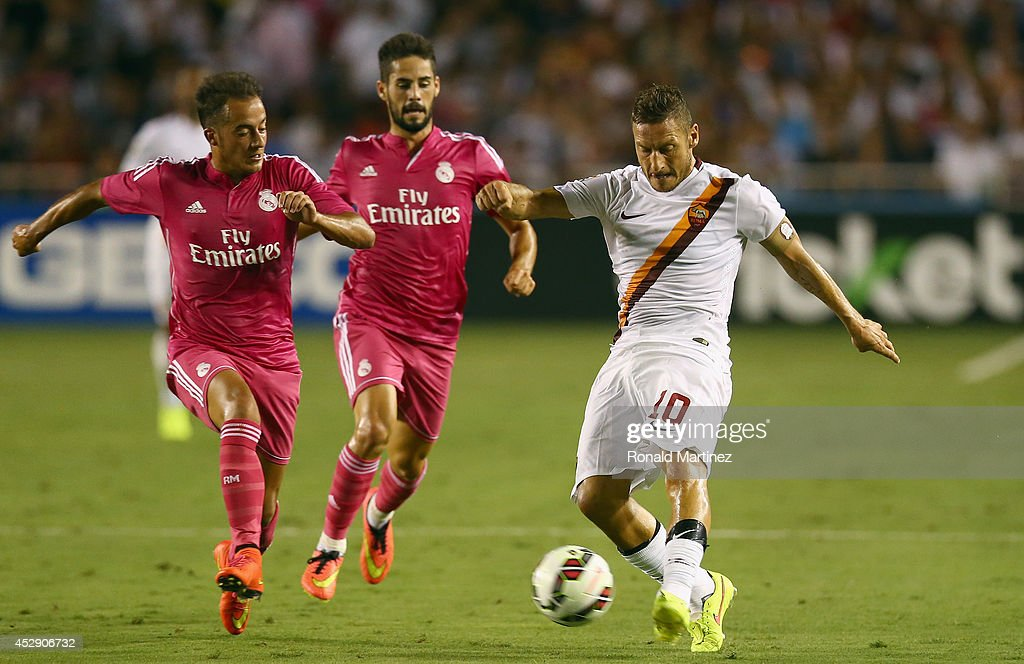 Francesco Totti #10 of AS Roma dribbles the ball against Real Madrid during a Guinness International Champions Cup 2014 game at Cotton Bowl on July 29, 2014 in Dallas, Texas.