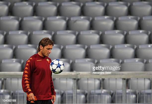Francesco Totti of AS Roma focusses a ball during a training session at Allianz Arena stadium ahead of the Champions League first round match between...