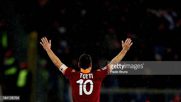 Francesco Totti of AS Roma greets his fans seen from behind during the Serie A match between AS Roma and Parma FC at Stadio Olimpico on March 17 2013...
