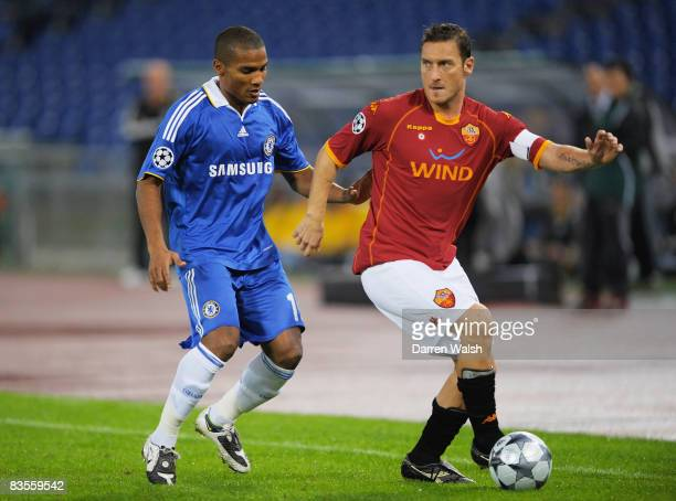 Francesco Totti of AS Roma holds off Florent Malouda of Chelsea during the UEFA Champions League Group A match between AS Roma and Chelsea at the...