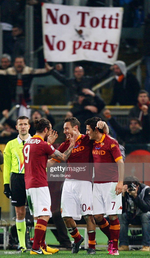 Francesco Totti (C) of AS Roma is congratulated by team-mates after scoring the opening goal of the Serie A match between AS Roma and Juventus FC at Stadio Olimpico on February 16, 2013 in Rome, Italy.