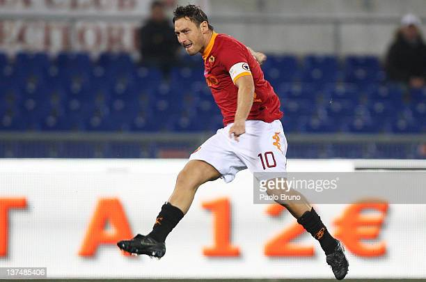 Francesco Totti of AS Roma scores the opening goal during the Serie A match between AS Roma and AC Cesena at Stadio Olimpico on January 21, 2012 in...