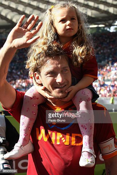Francesco Totti of AS Roma with his daughter Chanel on his shoulders celebrates victory after the Serie A match between AS Roma and Cagliari Calcio...