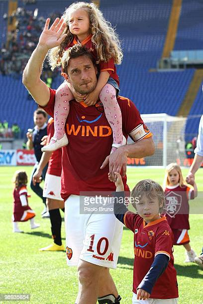 Francesco Totti of AS Roma with his daughter Chanel on his shoulders and son Cristian celebrates victory after the Serie A match between AS Roma and...