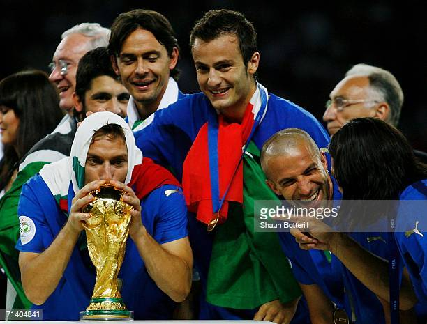 Francesco Totti of Italy kisses the World Cup trophy following his team's victory in a penalty shootout at the end of the FIFA World Cup Germany 2006...