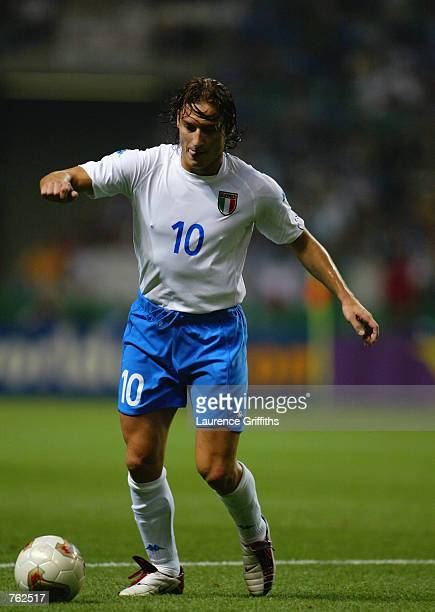 Francesco Totti of Italy runs with the ball during the FIFA World Cup Finals 2002 Group G match between Italy and Mexico played at the Oita Big Eye...