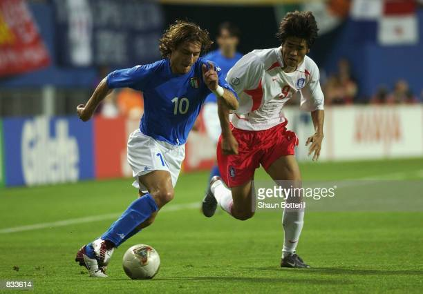 Francesco Totti of Italy takes the ball past Ki Hyeon Seol of South Korea during the FIFA World Cup Finals 2002 Second Round match played at the...