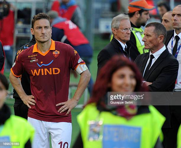Francesco Totti of Roma and Aurelio Andreazzoli head coach of Roma after the TIM cup final match between AS Roma v SS Lazio at Stadio Olimpico on May...