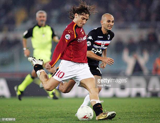 Francesco Totti of Roma attempts to control the ball from Giulo Falcone of Sampdoria during the Serie A Roma v Sampdoria match on December 5 2004 at...
